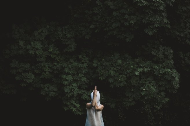 a-figure-in-white-gauze-strikes-a-pose-in-the-woods